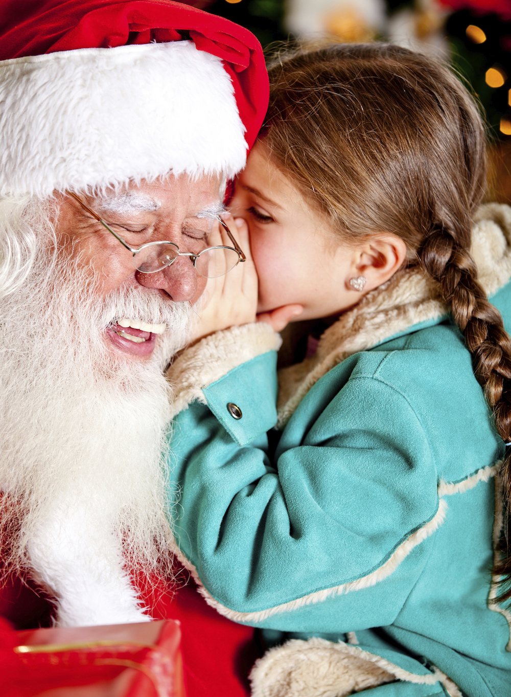 Little girl telling a secret to Santa Claus