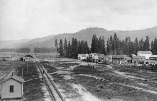 The newly constructed railroad and G Street in 1884